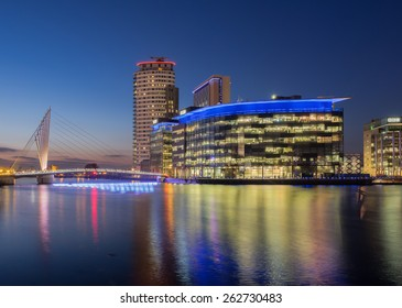 Manchester, UK - March 14, 2015: Salford Quays, Manchester. Night view of the BBC and ITV studio complex at Media City, Salford.