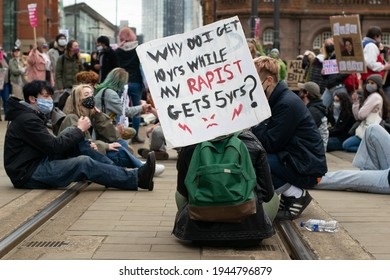 Manchester UK. March 27, 2021. Kill the Bill protest. Woman sat on Metrolink tramlines at St Peter's Square. Sign with ten years, five years text during the national lockdown in England.