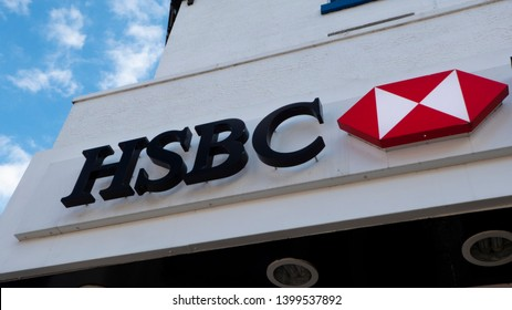 Manchester / UK - May 16 2019: HSBC bank facade with lettering and logo located in Manchester, UK.