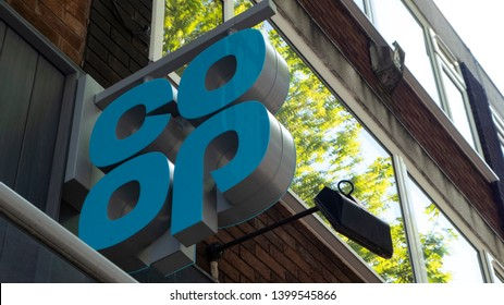 Manchester / UK - May 16 2019: Co-op market facade with lettering and logo located in Manchester, UK.