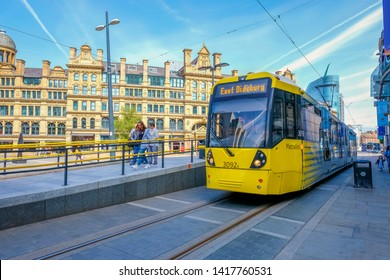 Manchester, UK - May 18 2018: Light rail Metrolink tram in the city center of Manchester, UK. The system has 77 stops along 78.1 km and runs through seven of the ten boroughs