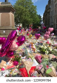 MANCHESTER / UK - MAY 2017: Thousands of flowers, balloons and cards are placed within St Anne's Square just days after the tragic Manchester Area Bombing attack.