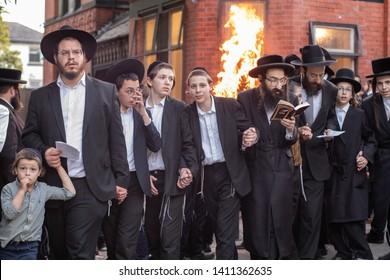 Manchester, uk. - MAY 23, 2019: Orthodox Jews celebrating Lag Ba'omer  singing and dancing by a bonfire Lag Baomer