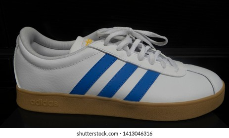 Manchester / UK - May 30 2019: Closeup of Adidas VL Court Leather 93 shoes in white and blue or sale in a shop in Manchester, UK