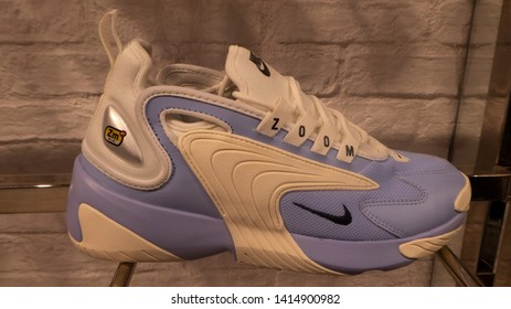 Manchester / UK - May 30 2019: Closeup of Nike Zoom 2K shoes in white and purple for sale in a shop located in Manchester, UK.