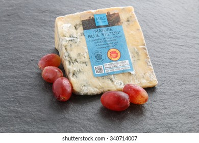 Manchester, UK - November 18th 2015:Mature Blue Stilton cheese - a favourite Christmas treat in Britain. Sold by Marks and Spencer as part of their Christmas food selection.