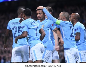 MANCHESTER, UK - OCTOBER 17, 2017: City players celebrate a goal during the UEFA Champions League Group F game between Manchester City and SSC Napoli at City of Manchester Stadium.