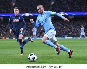 MANCHESTER, UK - OCTOBER 17, 2017: Piotr Zielinski  and David Silva pictured during the UEFA Champions League Group F game between Manchester City and SSC Napoli at City of Manchester Stadium.