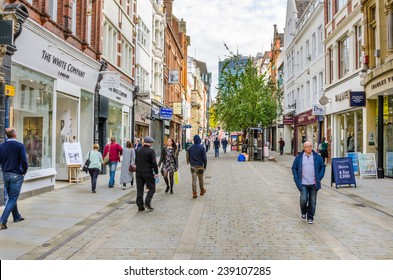 Manchester, Uk - October 3, 2014: Shoppers and tourists strolling around King Street on a warm autumn day. King Street (along with Bridge St.) is considered Manchester's most upmarket shopping area.