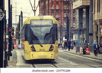 MANCHESTER, UK - SEPTEMBER 3, 2014: Light rail Metrolink tram in the city center. The system has 77 stops along 78.1 km and runs through seven of the ten boroughs. Toned photo