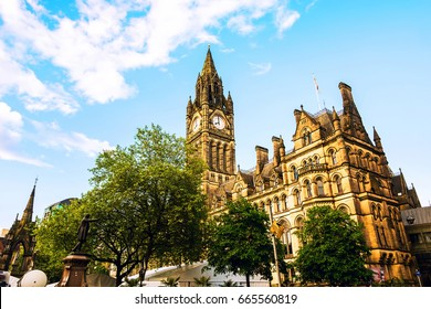 Manchester, UK. Town Hall of Manchester, UK with cloudy sky during the sunny day