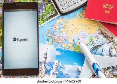 MANCHESTER, UNITED KINGDOM -27 JUNE 2016: Mobile apps make traveling so much easier. Plan your trip with EXPEDIA app.