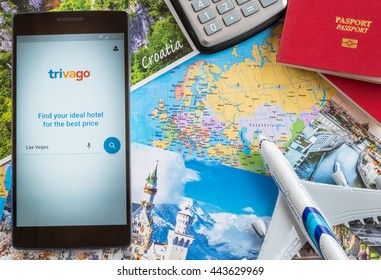 MANCHESTER, UNITED KINGDOM -27 JUNE 2016: Mobile apps make traveling so much easier. Compare hotel prices and get the best deals with TRIVAGO app.