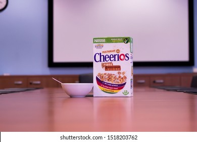 Manchester, United Kingdom - 29th Sept 2019 Box of Nestle Cheerios on an office boardroom  with a bowl.