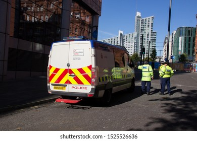 Manchester, United Kingdom - 30th Sept 2019: Police riot van with police officers standing next to it,