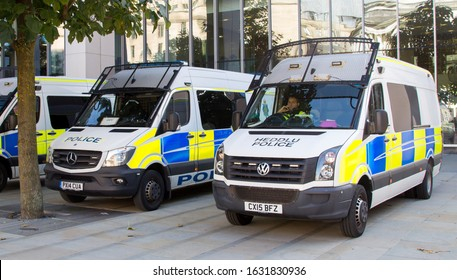 Manchester, United Kingdom - 31st Jan 2020: British police riot public order vans with the words Heddlu and police.