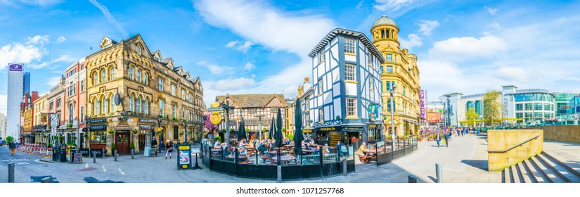 MANCHESTER, UNITED KINGDOM, APRIL 11, 2017: Restaurants full of people on the Shambles square in Manchester, England