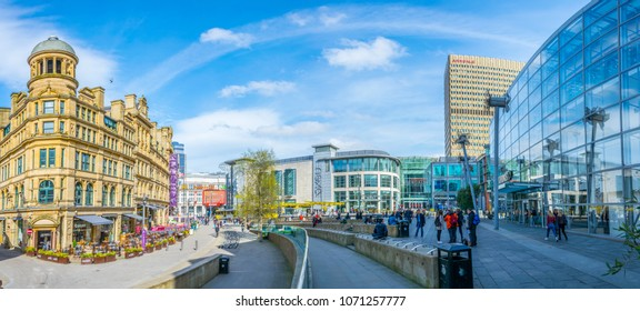 MANCHESTER, UNITED KINGDOM, APRIL 11, 2017: People are walking on the exchange square in Manchester, England