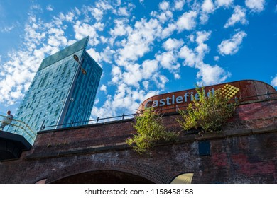 Manchester, United Kingdom - July 22, 2018: Castlefield and The Beetham Tower in Manchester. Classical buildings of the Industrial Revolution are gradually being replaced by modern construction