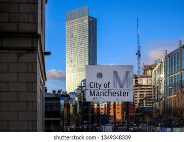 Manchester / United Kingdom - March 25, 2018 : A beautiful establishing shot of the Manchester skyline, behind the city of Manchester sign.