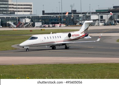 Manchester, United Kingdom - May 08, 2016: Private Bombardier Learjet 45 mid-size business jet aircraft (N700KG) taxiing on Manchester International Airport tarmac.