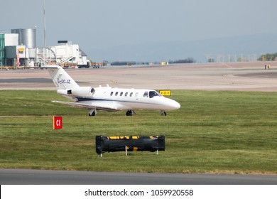 Manchester, United Kingdom - May 11, 2017: Centreline Cessna Citation CJ2 taxiing on Manchester International Airport runway.