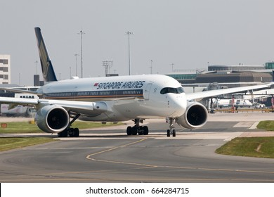Manchester, United Kingdom - May 11, 2017: Singapore Airlines Airbus A350-900 passenger plane (9V-SMG) taxiing on Manchester International Airport tarmac.