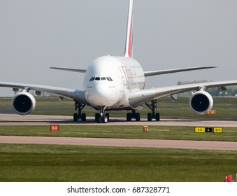 Manchester, United Kingdom - May 11, 2017: Emirates Airbus A380-861 passenger plane (A6-EDT) taxiing on Manchester International Airport tarmac after landing.