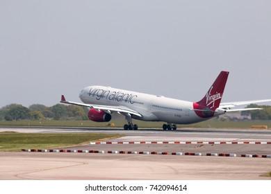 Manchester, United Kingdom - May 11, 2017: Virgin Atlantic Airbus A330-300 passenger plane (G-VKSS) taking off from Manchester International Airport runway.