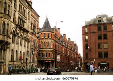 MANCHESTER, UNITED KINGDOM - MAY 27, 2017: Unique old red brick and victorian buildings in Albert Square in Manchester's city center on a bright but overcast day