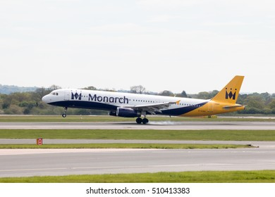 Manchester, United Kingdom - May 8, 2016: Monarch Airlines Airbus A320-231 narrow-body passenger plane landing to Manchester International Airport runway.