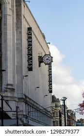 Manchester/England - 13.10.2013: Manchester Debenhams store exterior with clock