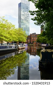 Manchester,Greater Manchester,England.9.13.2019.Moored Barges along Castlefield Basin with Beetham Tower skyscraper in the background.