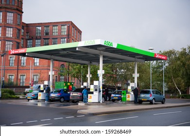 MANCHESTER-OCT 14: Asda Petrol Station on Oct. 14, 2013 in Manchester(Ashton-under-Lyne), United Kingdom, Great Britain, England, UK. Asda is the UK's second largest chain by market share after Tesco.