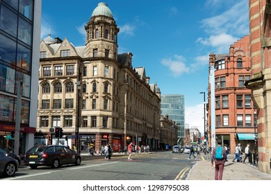 MANCHESTER,UK - AUGUST 10, 2018: Deansgate street - a main road (part of the A56) through Manchester city centre, one of the city's oldest thoroughfares.