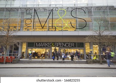 MANCHESTER,UK - DECEMBER 10: Christmas shoppers in front of Mark's & Spencer's, Manchester December 10, 2013. M&S is a major retailer with 1,010 stores which specializes in fashion and luxury goods.