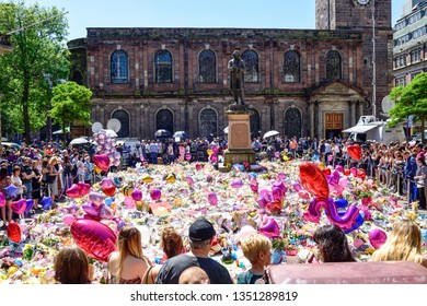 Manchester,UK: May 26th  2017: The ocean of floral tributes grows in St Ann's square in the heart of the city centre following a terrorist bombing attack at Manchester arena.