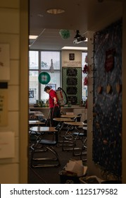 Man/Cleaner cleaning the class for the coming back to school. InEast High School in Salt Lake CIty, Utah, USA in January of 2018