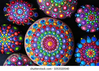 Mandala dot painting colorful stones background