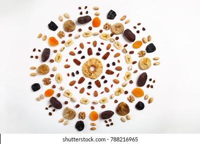 mandala shapded  mix of dried fruits and nuts - symbols of jewish holiday Tu Bishvat