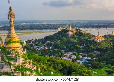 Mandalay city with golden temples and Irrawaddy river, view from sagaing hill, The old city of religion and culture outside Mandalay, Myanmar.
