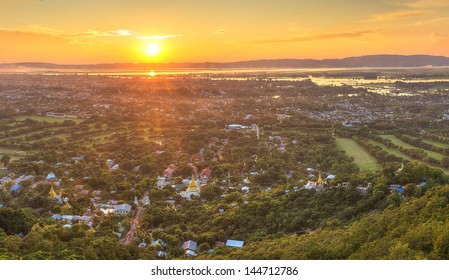 Mandalay with lake mountains, temples and pagodas seen from mandalay hill at sunset, Burma