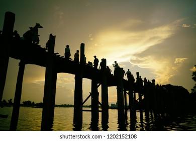 Mandalay, Myanmar - 30 Sep 2018: Sunset at U Bein bridge, The longest wooden bridge in the world