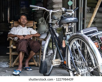 Mandalay, Myanmar - Apr 12 2018: Rikshaw portrait with his new bicycle