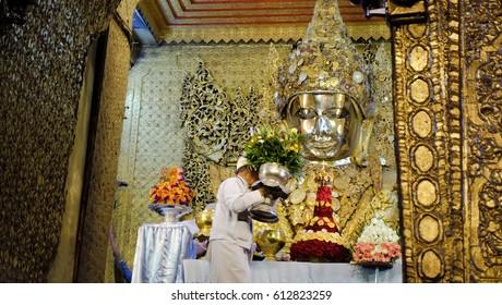 MANDALAY, MYANMAR - CIRCA MARCH, 2017 : The Buddha image wash ceremony in the morning at Mahamuni temple in Mandalay, Myanmar.