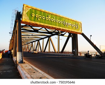 MANDALAY, MYANMAR - DECEMBER 13, 2014: Transportation and traffic on the way to Mandalay Hill in the evening