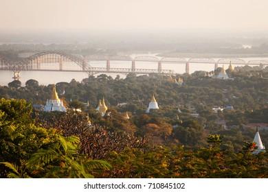 MANDALAY, MYANMAR - December 2014: Aerial view of Mandalay city with golden temples and Irrawaddi river view, Mandalay, Myanmar