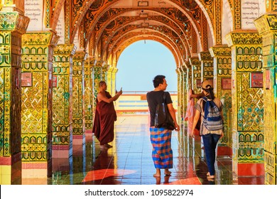 MANDALAY, MYANMAR - DECEMBER 22, 2014 : indoor photography of People walking at Mandalay Hill one of the most famous Tourist attraction In Mandalay, Myanmar.