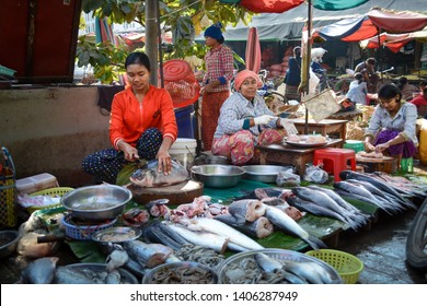 Mandalay, Myanmar - December 31 2016: Women cleaning and selling fish in Zay Cho Market, the biggest traditional market in Myanmar. Scene of ordinary life in the morning.