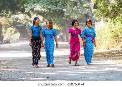 MANDALAY, MYANMAR - FEB 10, 2017: Burmese woman holding traditional walking near U Bein Bridge